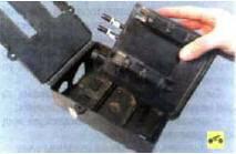 13. Извлеките адсорбер из кожуха.