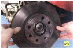 4. …и снимите тормозной диск.
